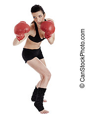 Woman doing boxing poses with red gloves