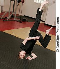 woman doing capoeira handstand