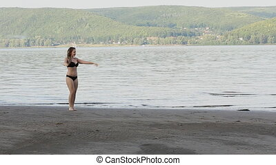 Woman Doing Cartwheel on beach - Sexy girl doing Cartwheel...