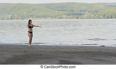 Woman Doing Cartwheel on beach - Sexy girl doing Cartwheel...