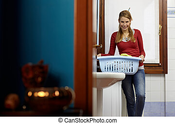 woman doing chores with washing machine