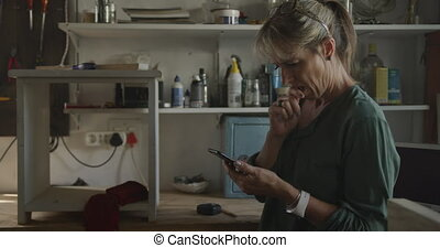 Woman doing DIY at home - Side view of a Caucasian woman ...