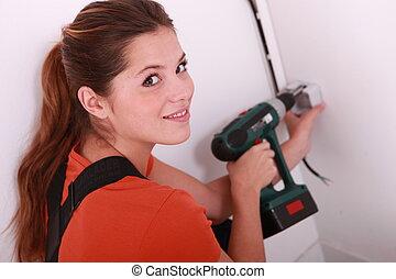Woman doing DIY at home