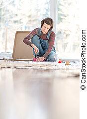Woman doing DIY repairs at home