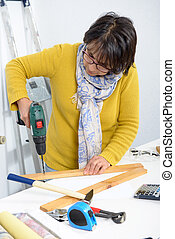 Woman doing DIY work at home