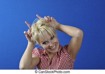 woman doing ears with her fingers
