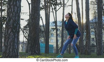 Woman doing erotic dance movement in the park. slow motion, 120fps