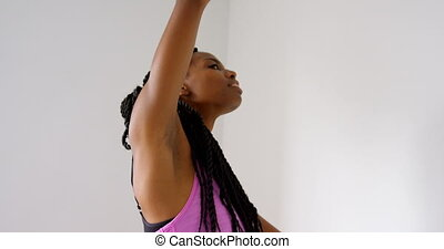 Woman doing exercise in fitness studio 4k