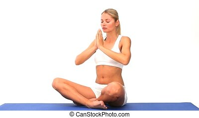 Woman doing exercise of relaxation on a blue ground cloth