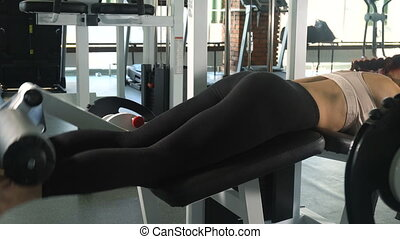 Woman doing exercise on her buttocks