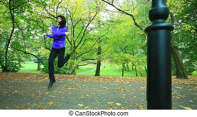 Woman doing exercise with jump rope