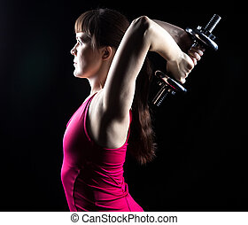 Woman doing exercise with weights