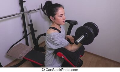 Woman doing exercises for biceps