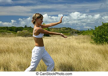 woman doing exercises in a field