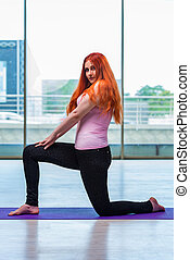 Woman doing exercises in gym