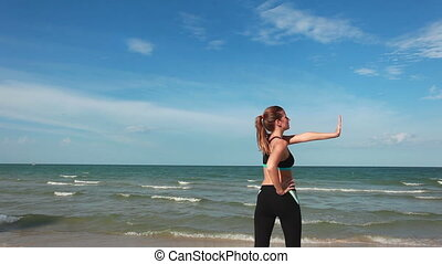Woman doing exercises near the sea
