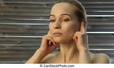 woman doing face fitness, aging chang in the muscles of the face