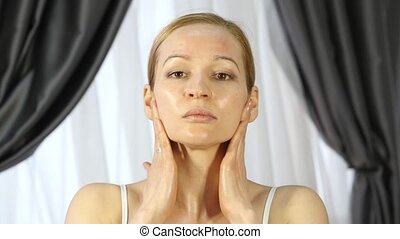woman doing face fitness, aging chang in the muscles of the...