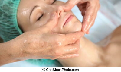 Woman doing facial massage
