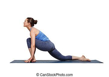 Woman doing Hatha yoga asana Anjaneyasana - low crescent...