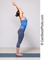 Woman doing Hatha Yoga asana Tadasana - Mountain pose with...