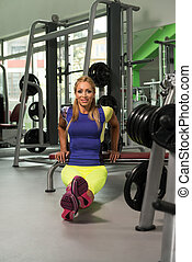 Woman Doing Heavy Weight Exercise On Bench