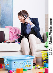 Woman doing housework and calling mobile phone the same time...