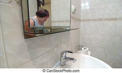 Woman doing housework cleaning bathroom - Woman doing...