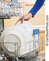 woman doing housework - close up of woman in kitchen using...