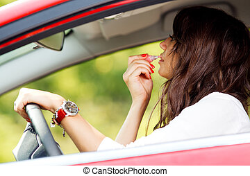 Woman doing makeup while driving