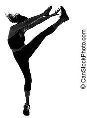 Woman doing martial arts kicking the air