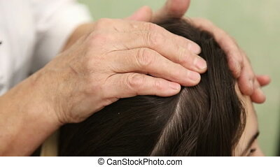 Woman doing massage of the head