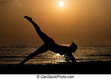 Woman Doing Meditation Near Ocean Beach Yoga Silhouette