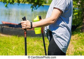 Woman doing nordic walking in  park