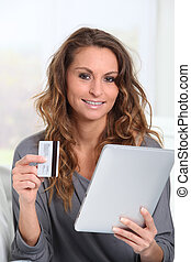 Woman doing online shopping at home