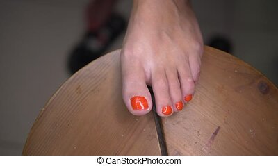 Woman doing pedicure by herself - Closeup of woman's foot...