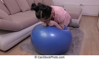 Woman doing plank on fitness ball