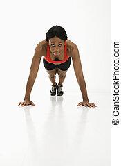 Woman doing push up.