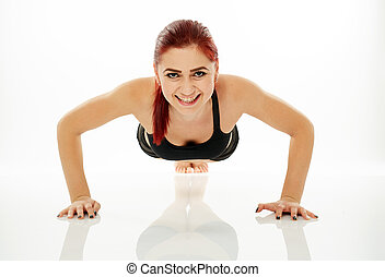 Woman doing pushups