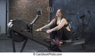 woman doing rowing machine workout