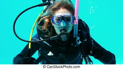 Woman doing scuba training in swimming pool on her holidays