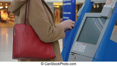 Woman doing self-check in at the airport