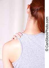 self shoulder massage - woman doing self shoulder massage