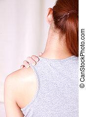 self shoulder massage - woman doing self shoulder massage