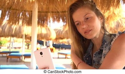 Woman doing selfie using smartphone