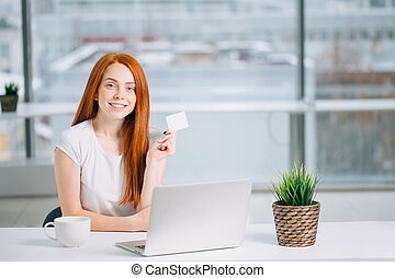 woman doing shopping online with her laptop at home