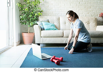Woman doing some workouts she found online