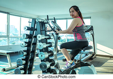 Woman doing sport in the gym for fitness - Young asian woman...