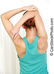 stretch - woman doing stretch at home