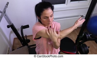 Woman doing stretching exercises before work out